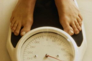 weighing yourself on scale